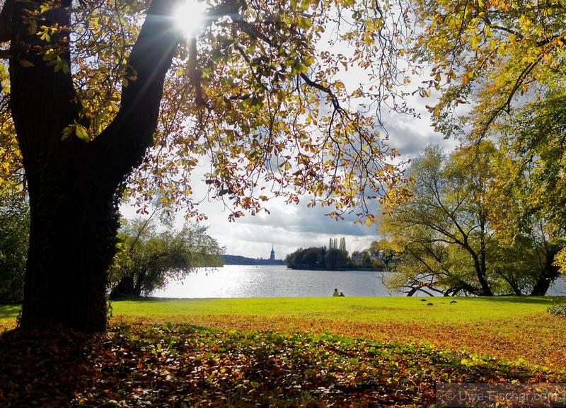 Two people enjoy the autumn sun in a park near Potsdam...